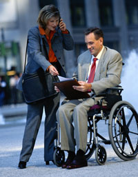 woman with man in wheelchair